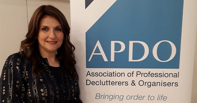 Rivka Caroline next to the APDO banner