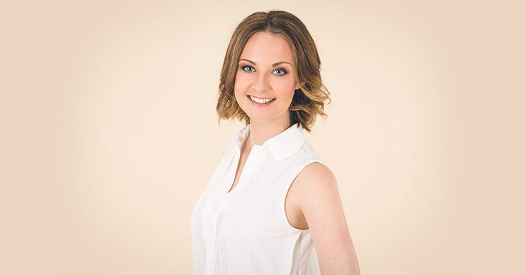 Claire Birnie, project 3000, in a white top smiling